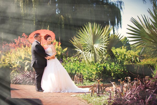 bride and groom standing in a beautiful summer garden for Chicago Wedding