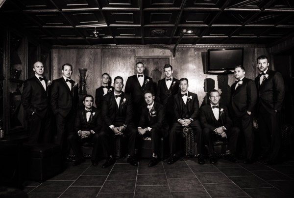 groom and groomsman group photograph on the wedding day dramatic style