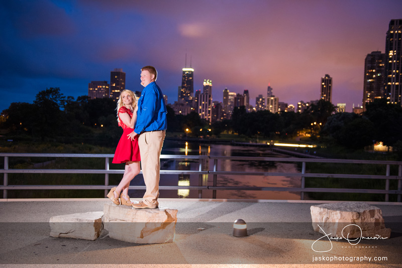 Engagement Photo at night overlookin Chicago Skyline Lighst From Lincoln Park ZOO