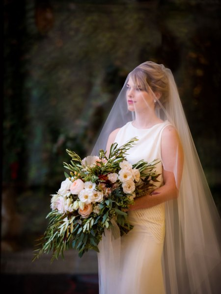 Chicago Wedding Bride Holding a Gorgeous Bouquet of Flowers with Veil Covering Her Face.
