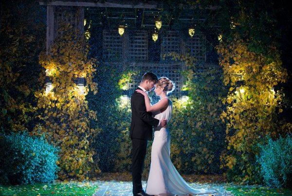 Chicago wedding photography at Galleria Marchetti Courtyard with Bride and Groom standing in the rain