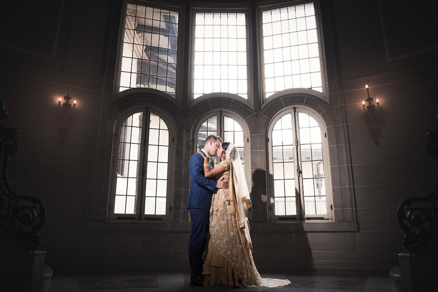 Indian Wedding Couple Kissing in a Fairytale Wedding Photograph