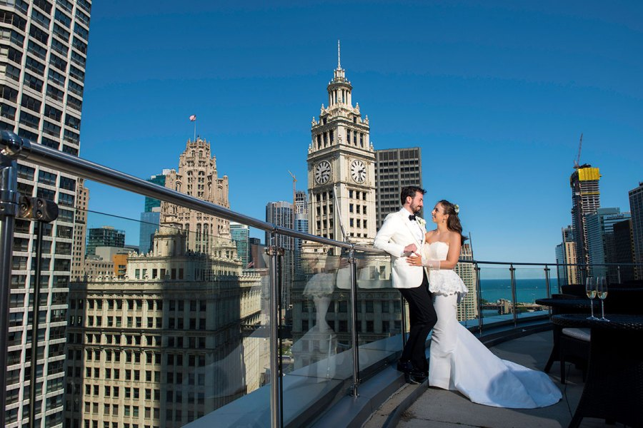 Bride and Groom Looking at Each Other at Historic Wrigley Building in Chciago