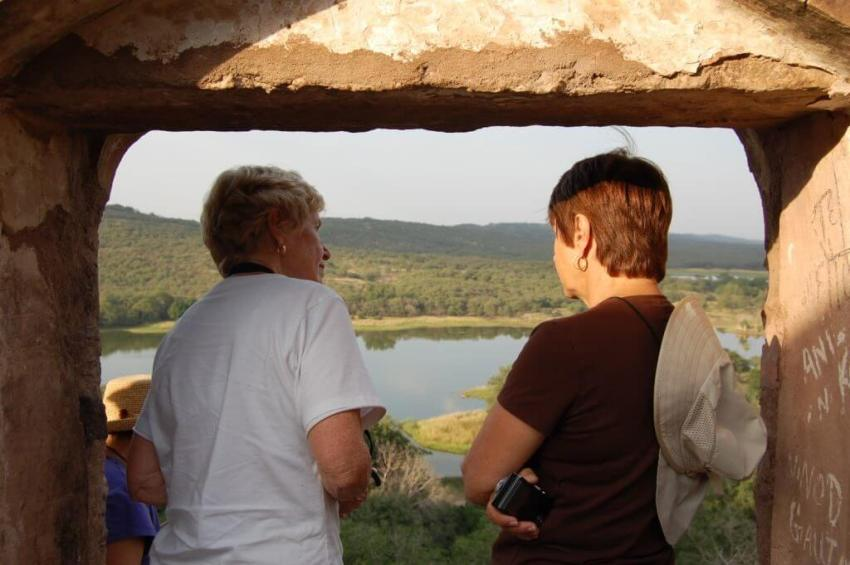 My guests looking out of a fort.