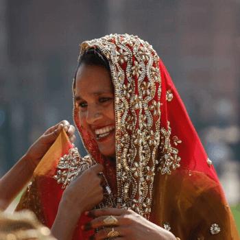 Custom designed tours. Lady in a red saree at the Taj Mahal