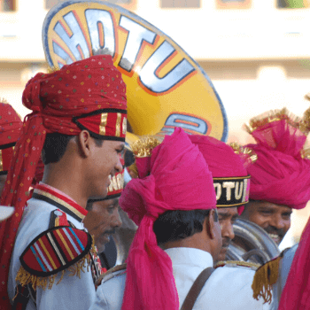 In the Image is a The Chotu Band resplendent in their turbans in Jaipur India
