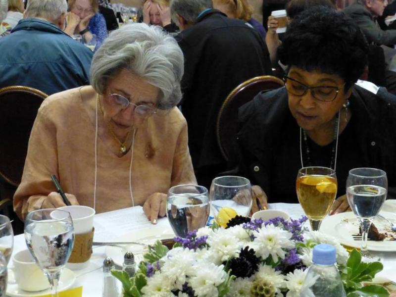 Clara Browda and Beverly Johnson, focusing intently on the day's quiz