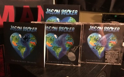 Triumphant Hearts signed by Jason Becker, Uli Jon Roth and Guthrie Govan