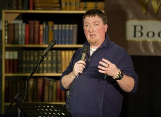 Jason Crane hosts poetry night at Websters Bookstore and Cafe on Wednesday, April 1, 2015. ABBY DREY — CDT photo