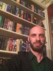 Standing in front of Robert Jordan's bookshelf. Every book you see is a Wheel of Time book from different parts of the world.