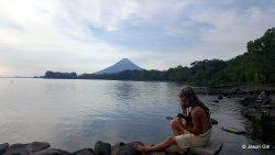 22. Ometepe Lake - David playing guitar near volcano