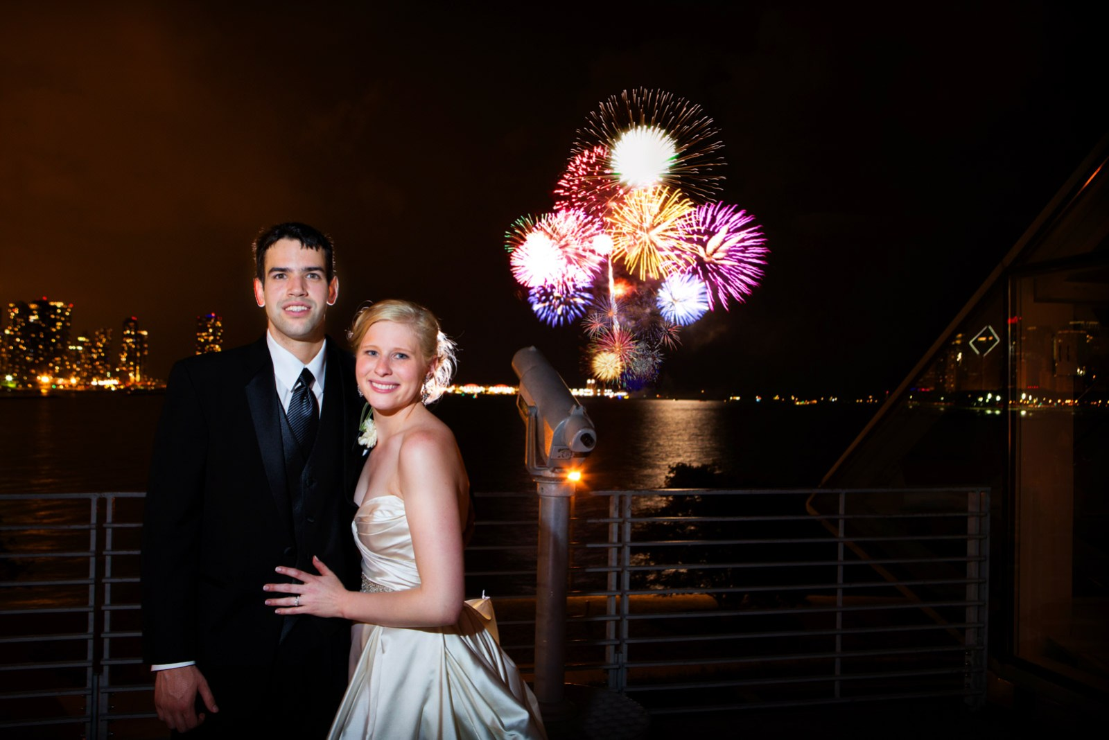 Bride and Groom at the Adler Planetarium with Fireworks from Navy Pier in the background