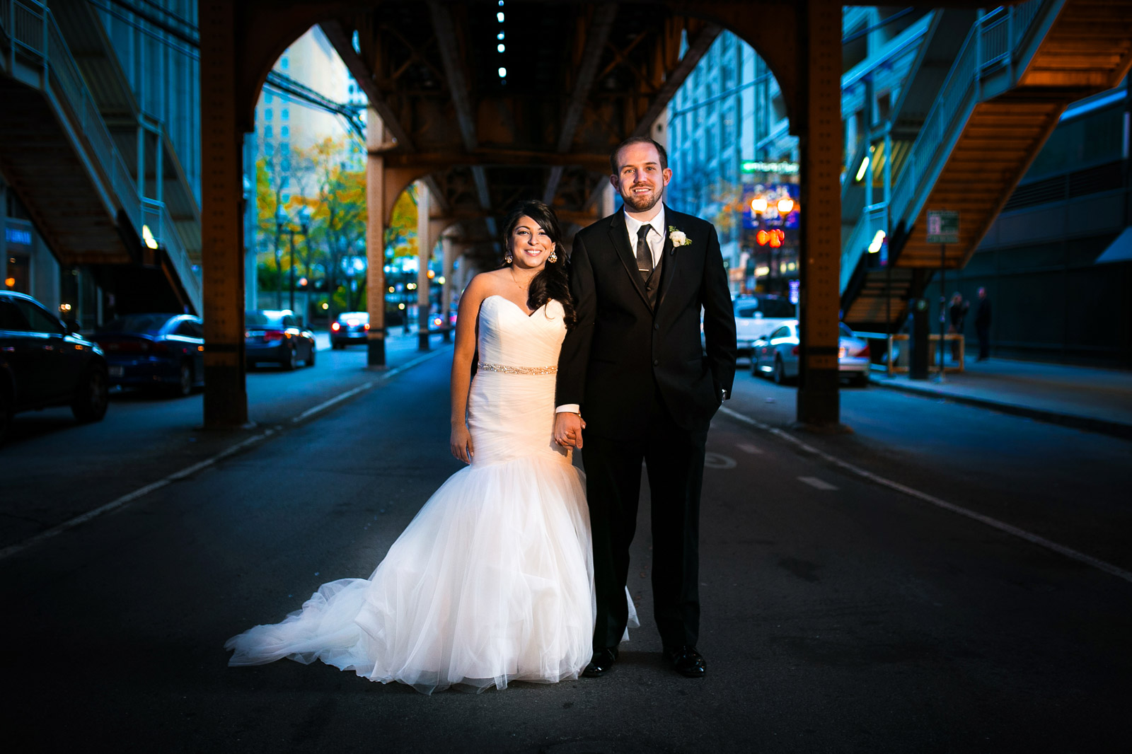Bride and Groomo in street under Chicago EL train track
