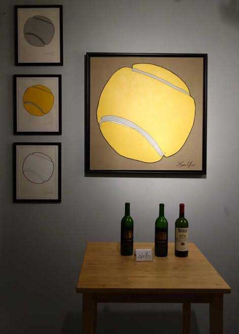 Tennis ball painting and small works on paper by Jason Oliva