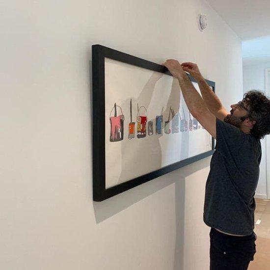 Jason Oliva hanging Jackson Pollock work on paper for Masahiro Tanaka NYC