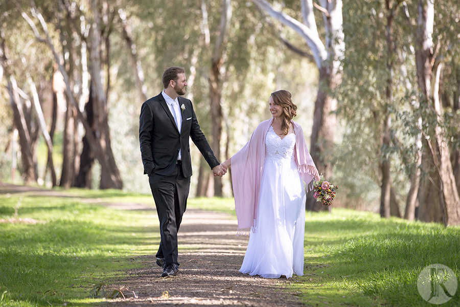 bride and groom walking along path in Wagga Wagga NSW