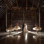 Bride and Groom in the Old Barn at Brown Brothers Winery with flower girls twirling