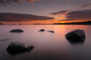 LAKE IN FINLAND AT SUNSET.