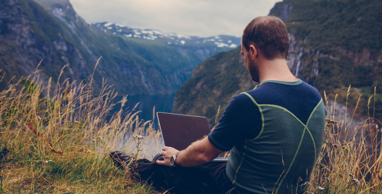 Man Staring at Blank Computer in the Mountains