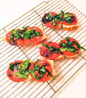 crapese crostini appetizer sitting on rack