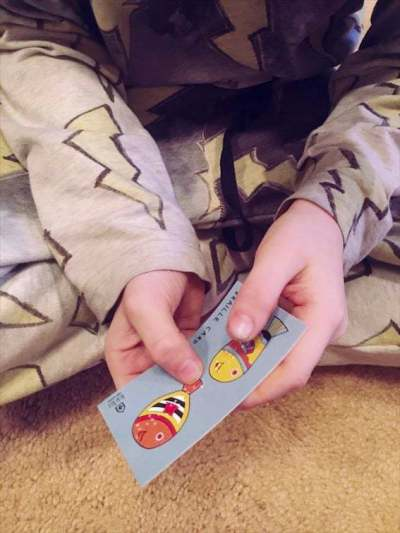 boy holding card with fish on it