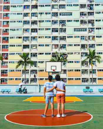 Boys hugging on basketball court. 5 Ways To Teach Your Child To Be Kind