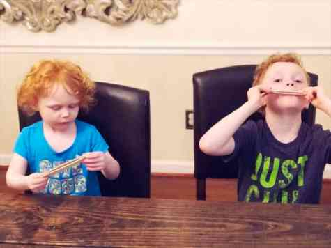 Kids Night In Box kids playing with craft harmonica