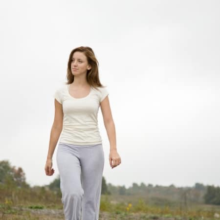 Learn how to declutter your mind with woman walking alone outside.
