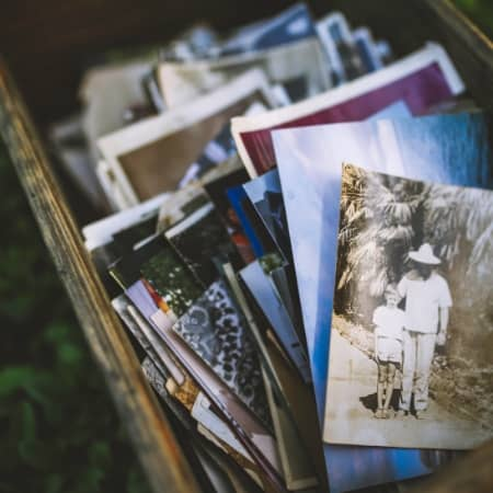 learn how to declutter sentimental items like these old photos in a box