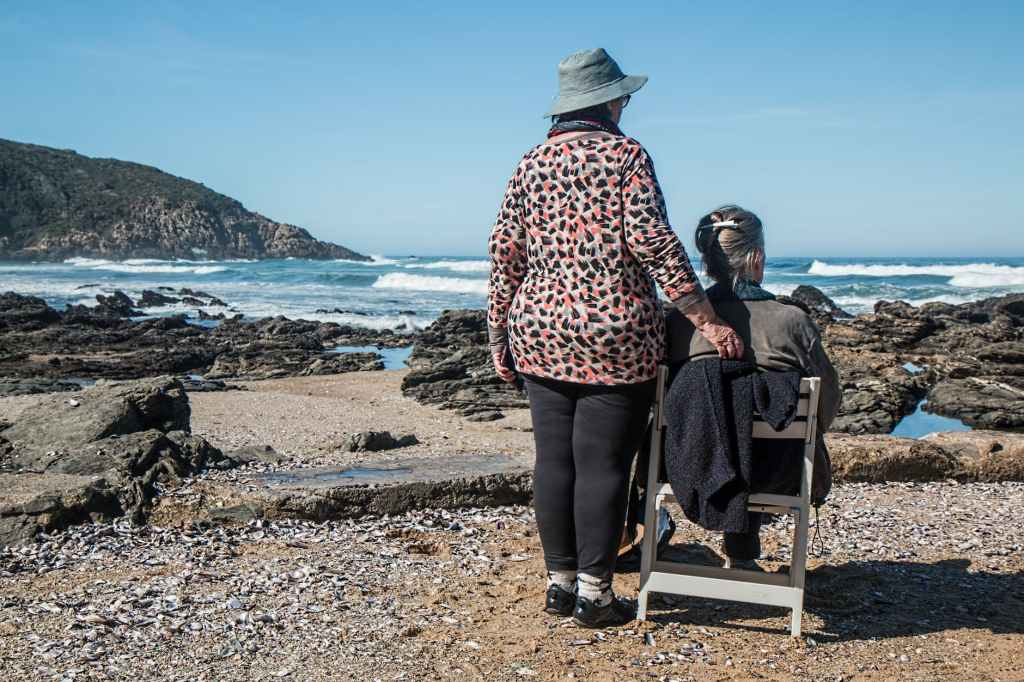 An old couple sat at the coast. 6 evidence-bevidence-based ways to help to prevent Alzheimer's.