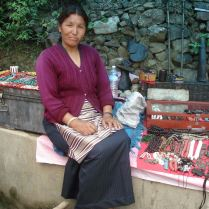 Tibetan lady selling braclets by the roadside