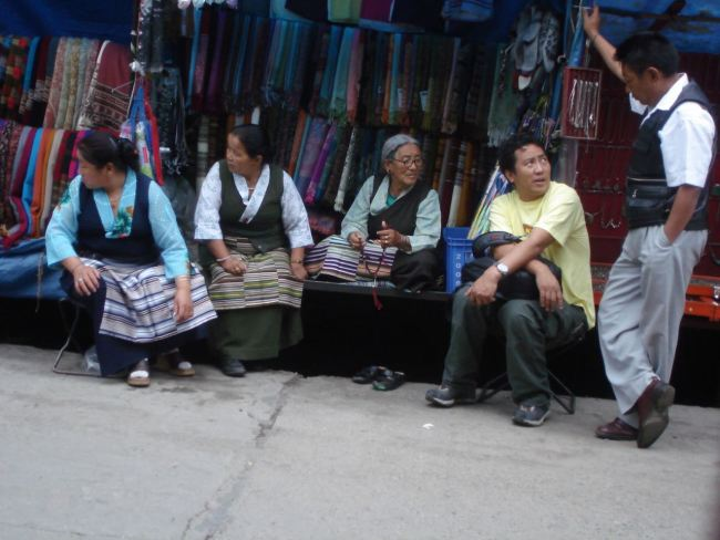 Tibetan ladies selling cloth by the streat