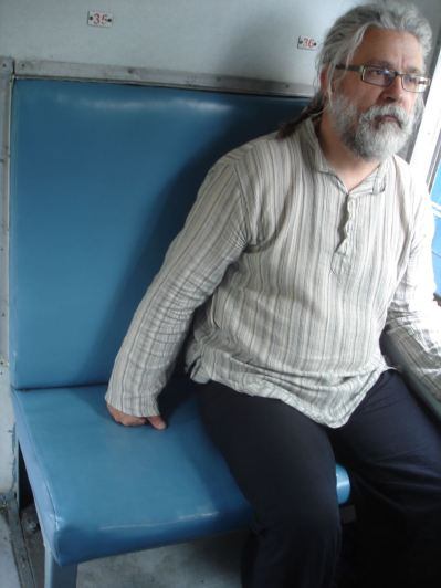 Me sitting on a narrow bench at Shimla Toy Train