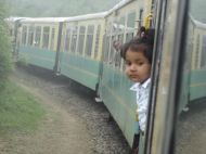 A little girl looking out of the Shimla Toy Train