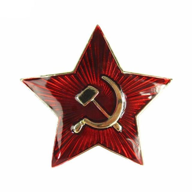 Röd stjärna med gul kant och hammaren och skära i mitten.