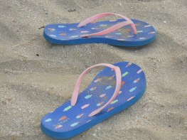 Tay's sandals sitting while she swims in the ocean