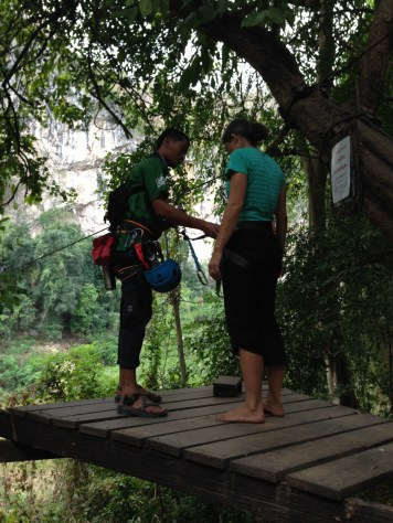 Nicole getting ready to cross over on the zip line