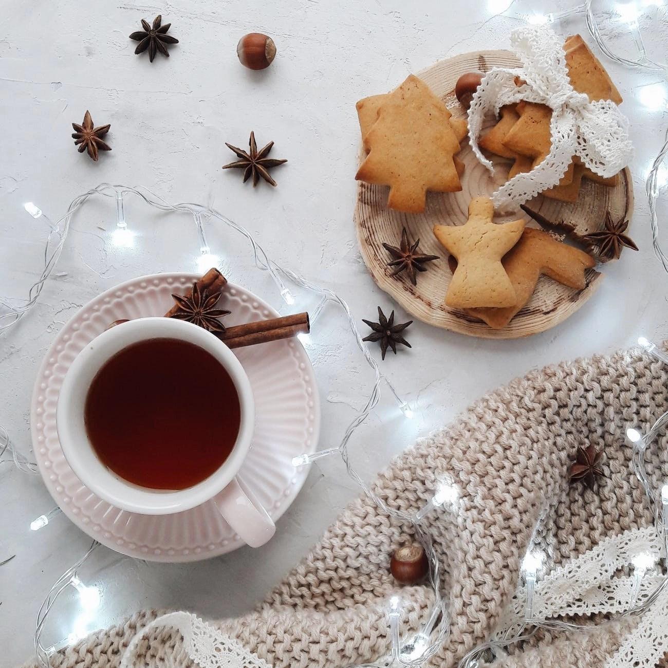 photo of white ceramic mug near cookies