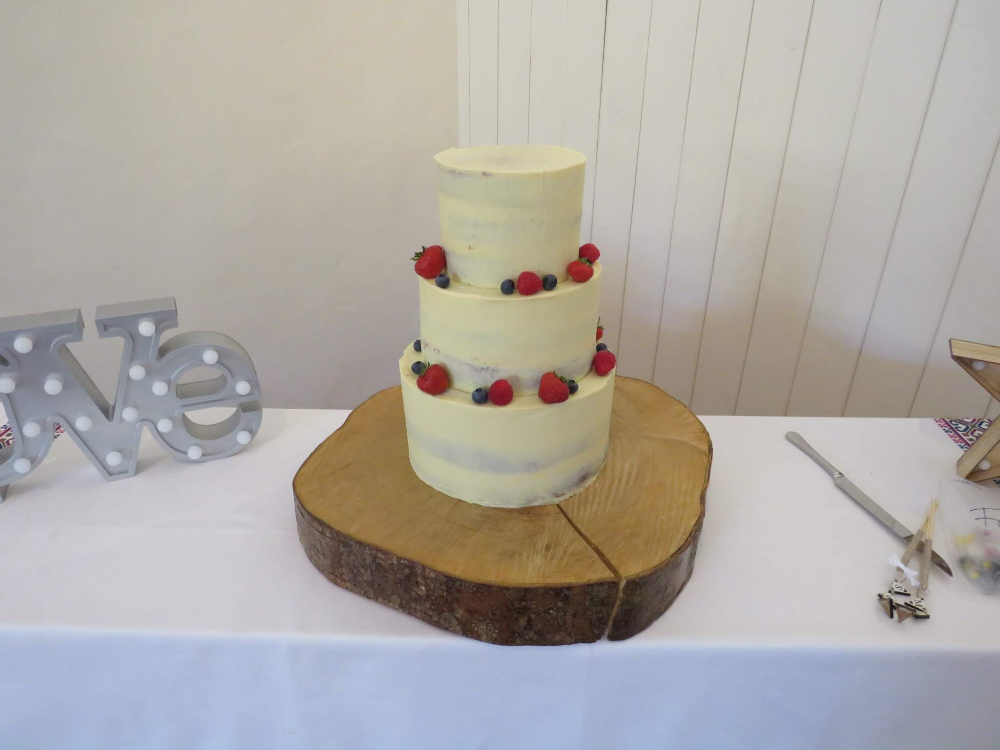 Semi-naked wedding cake fresh fruit