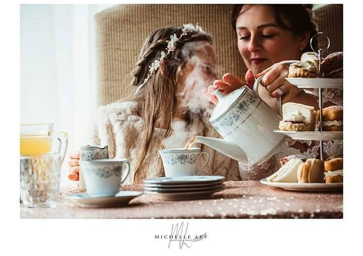 Bride & bridesmaid tucking in to an afternoon tea