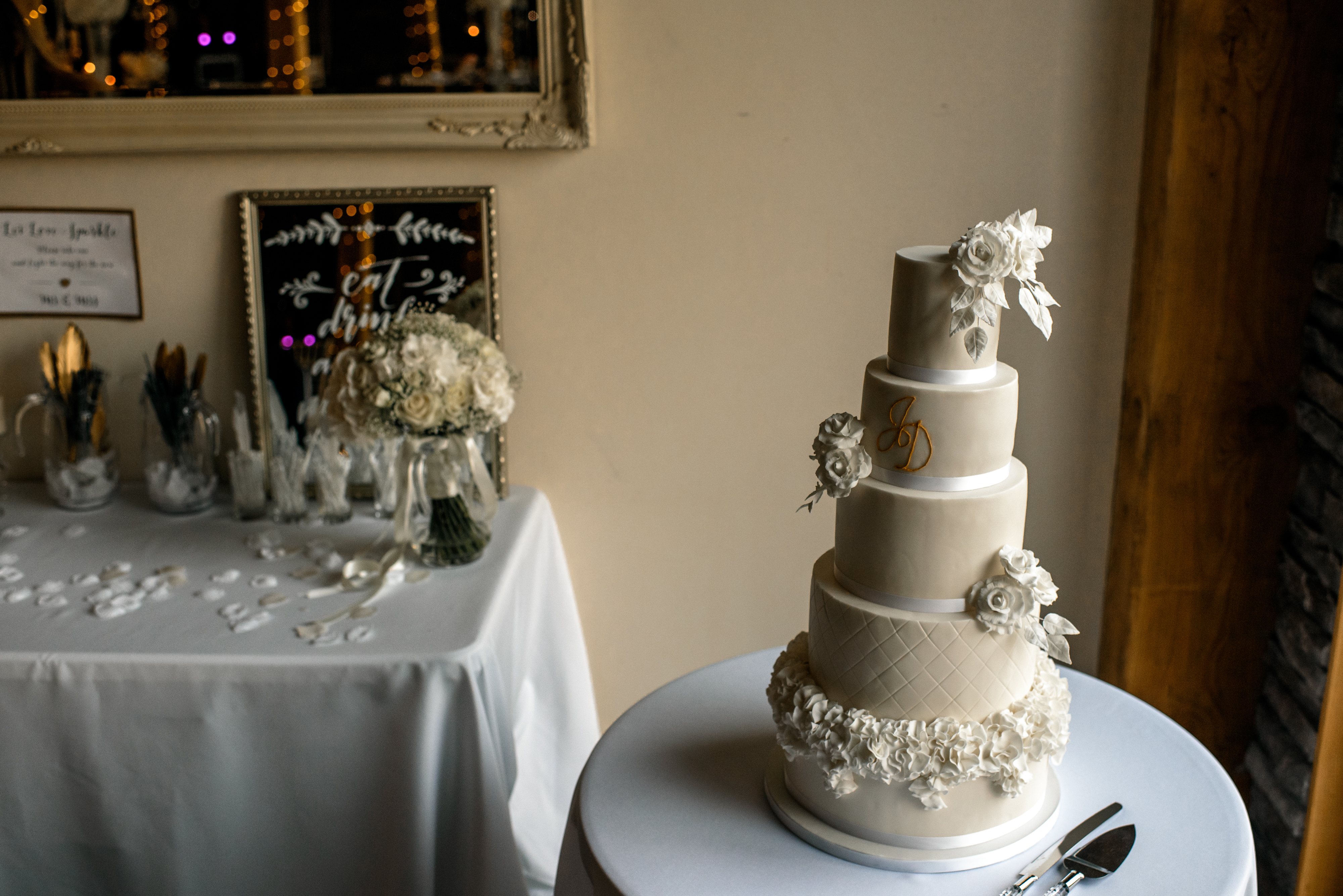 Jax's Cakes 'N' Bakes - Five tier wedding cake with white sugar roses