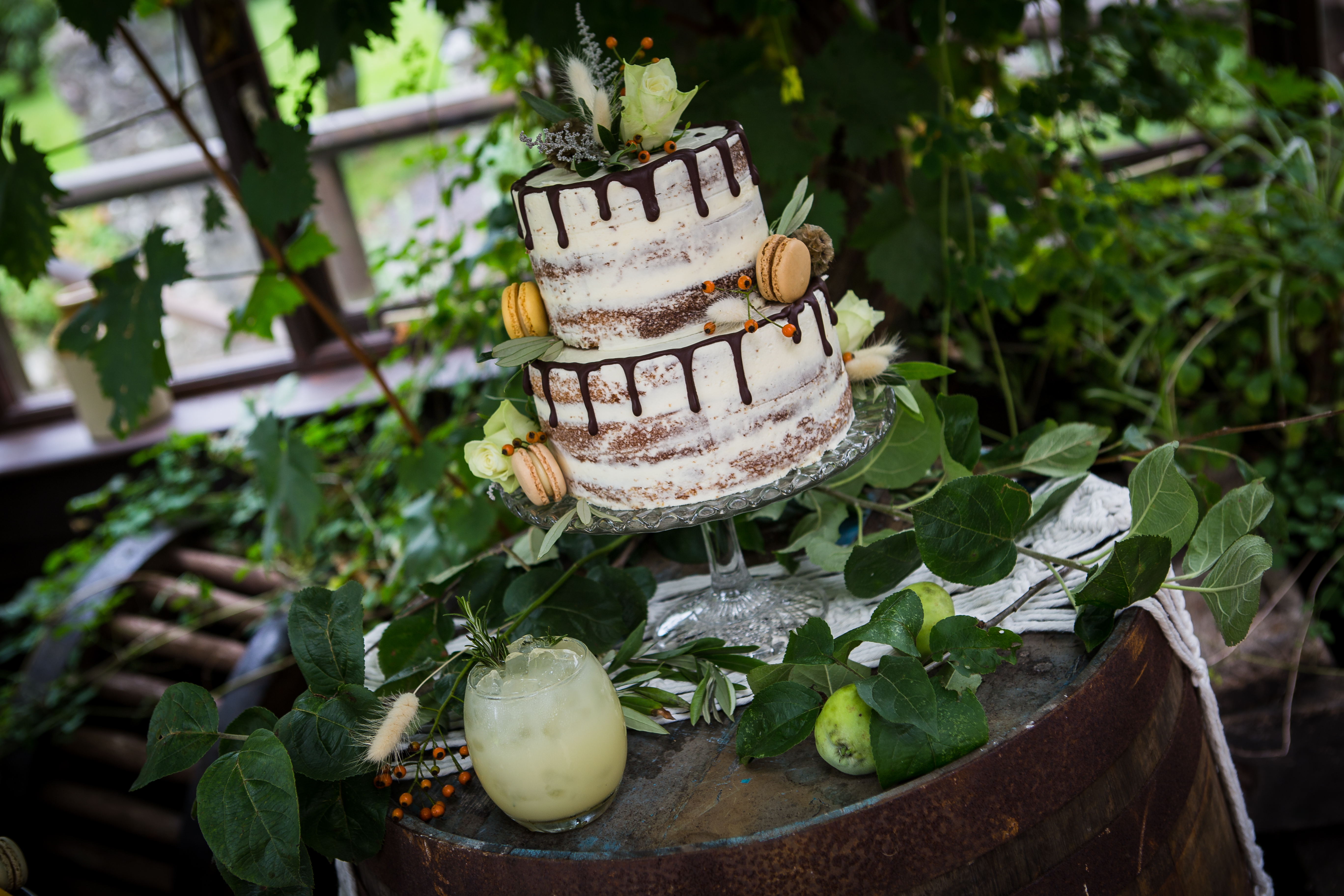 two tier semi-naked wedding cake with macaroons & drips