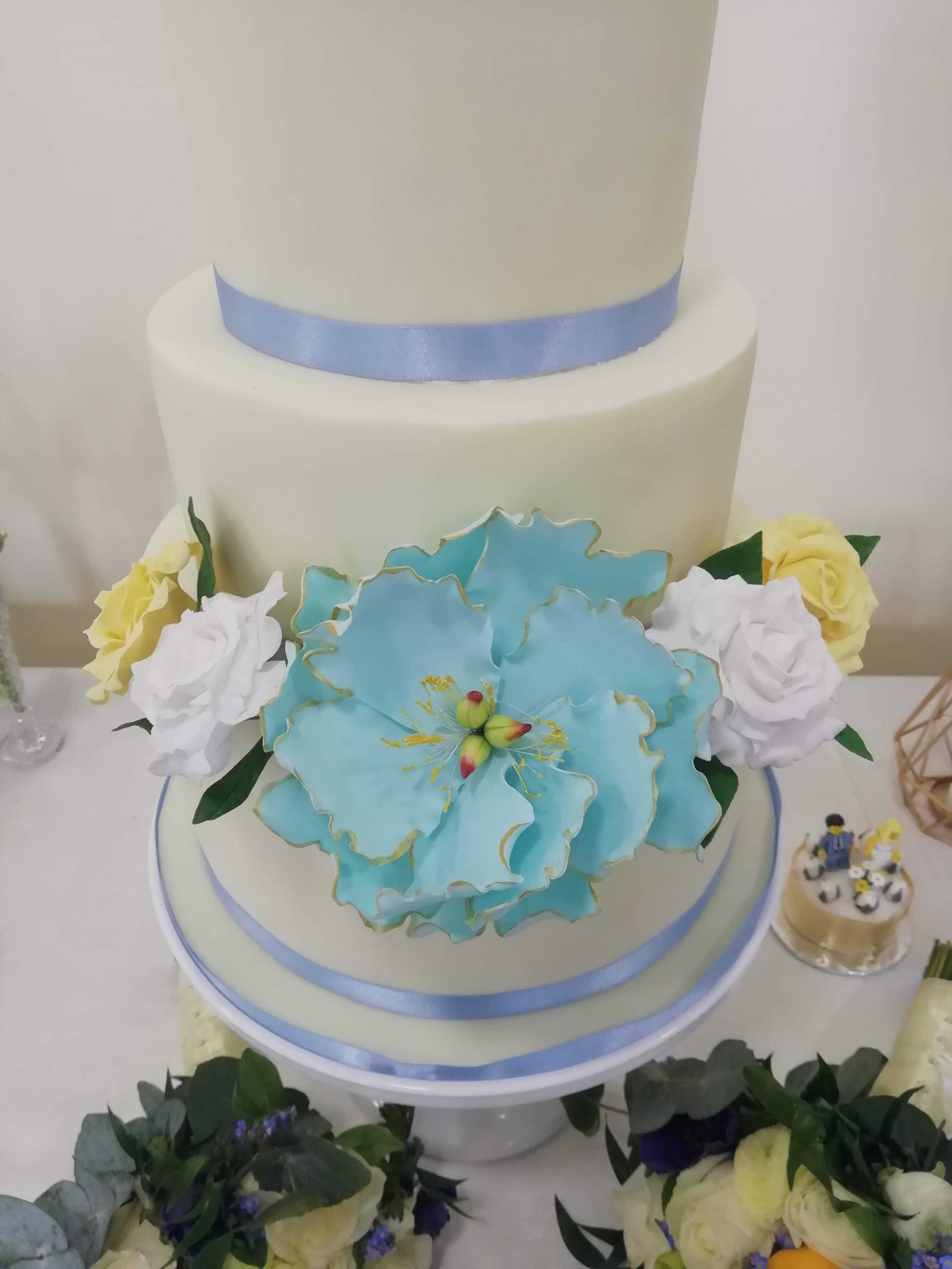 Bright blue peony with gold edge and white & yellow roses