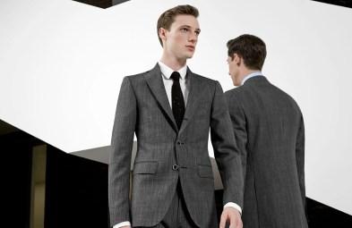Man wearing a grey suit for Jaxson Maximus suit color guide