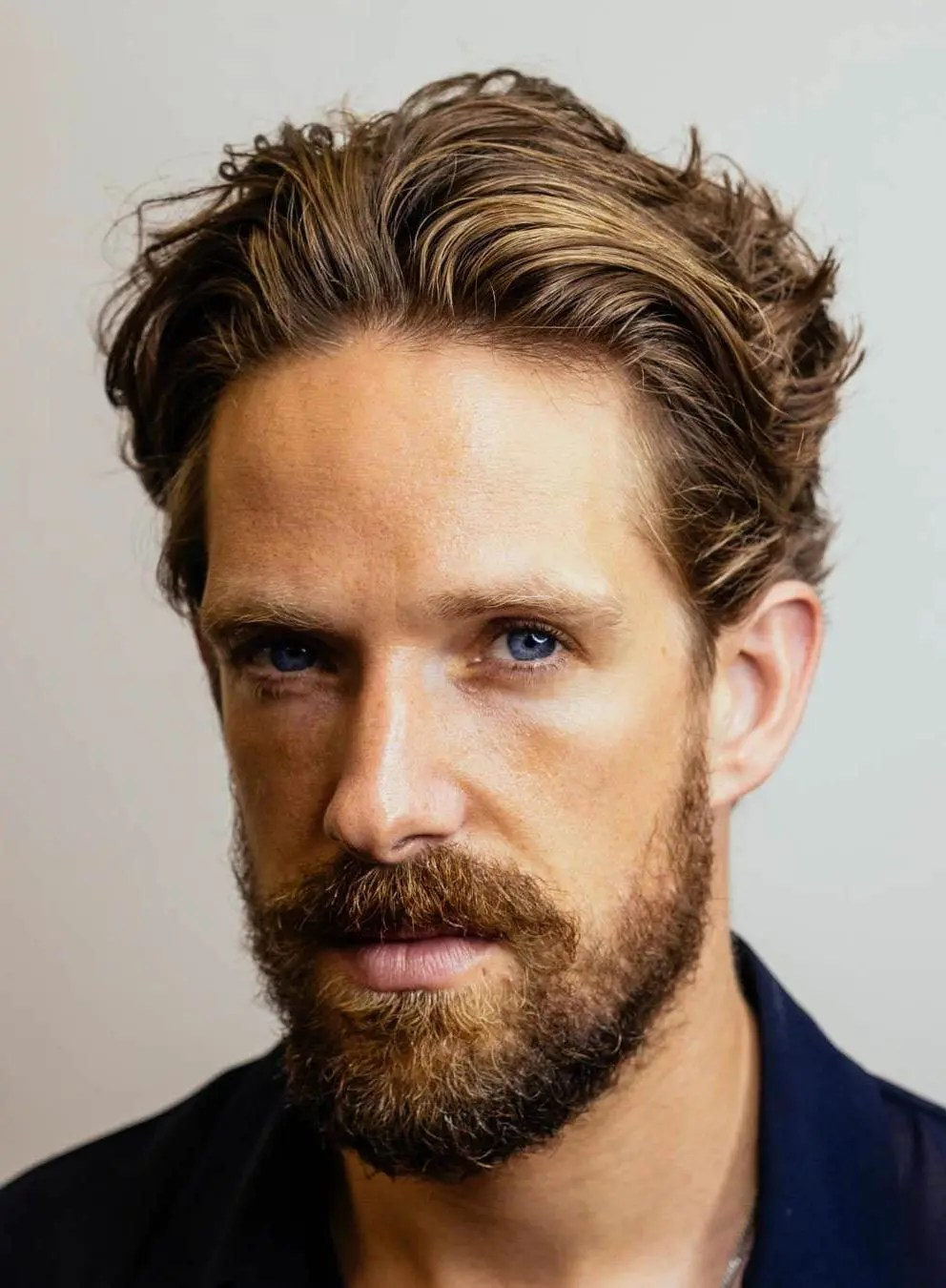 HAIRCUTS FOR MEN WITH CURLY HAIR slick back