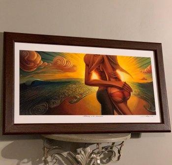 romantic couple on a beach art with sun rays