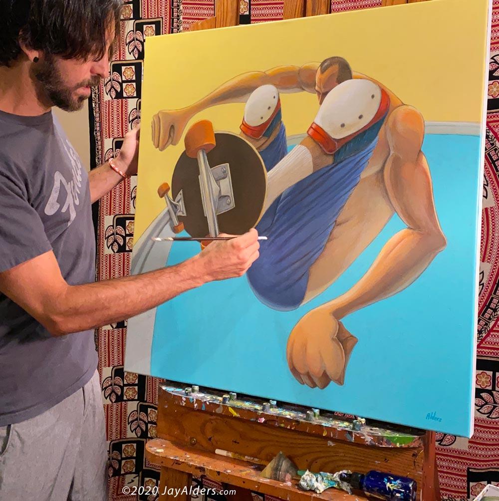 Artist and skater Jay Alders painting skate art of Jay Adams