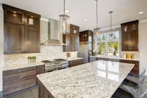 Luxury kitchen accented with large granite kitchen