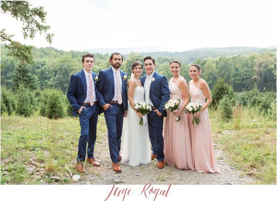 blue groomsmen and pink bridesmaids