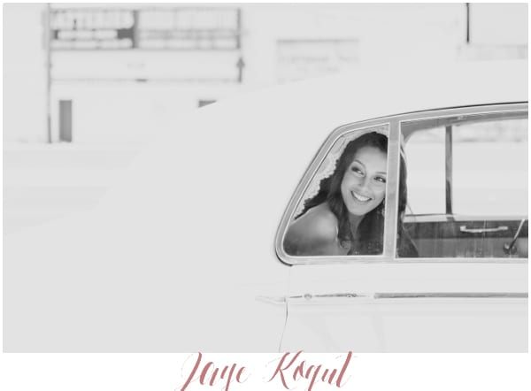 candid photo of bride smiling, bride in rolls royce, NJ wedding photographer